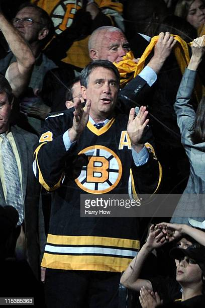 Former Bruins player Cam Neely cheers during Game Three between the Boston Bruins and the Vancouver Canucks in the 2011 NHL Stanley Cup Final at TD...