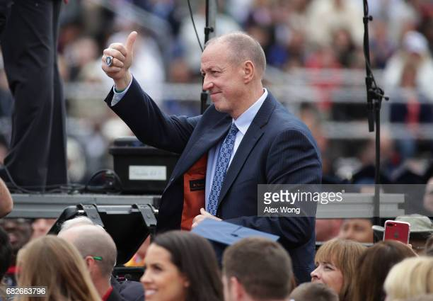 Former Buffalo Bills quarterback Jim Kelly is acknowledged by President Donald Trump during a commencement at Liberty University May 13 2017 in...