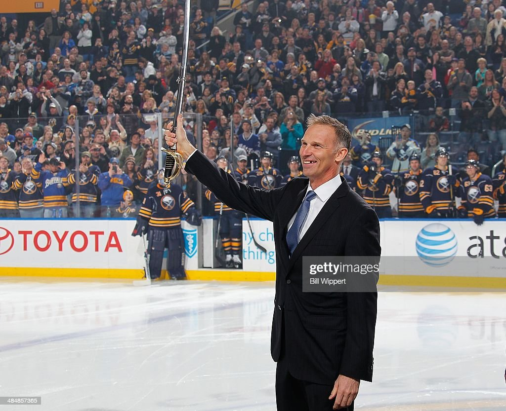 Former Buffalo Sabres goaltender Dominik Hasek flashes his saber to an appreciative crowd after being the 42nd member inducted into the Buffalo...