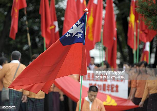A former Burmese national flag is displayed as Myanmar residents in Japan march to commemorate the 20th annivesary of the National League of...