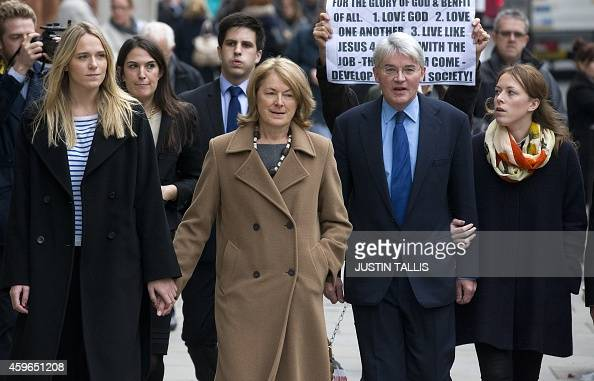 Former cabinet minister and Conservative MP Andrew Mitchell arrives with his wife Sharon Bennett and other supporters to hear the judges decision at...