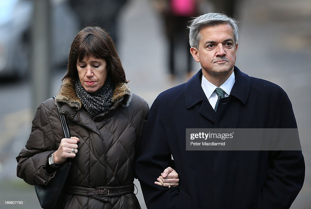 Former Cabinet Minister Chris Huhne arrives at Southwark Crown Court with Carina Trimingham on February 4, 2013 in London, England. Huhne, 58, and his ex-wife Vicky Pryce are on trial over allegations that Pryce, 60, took penalty points on her driving licence in 2003 so that he could avoid prosecution.