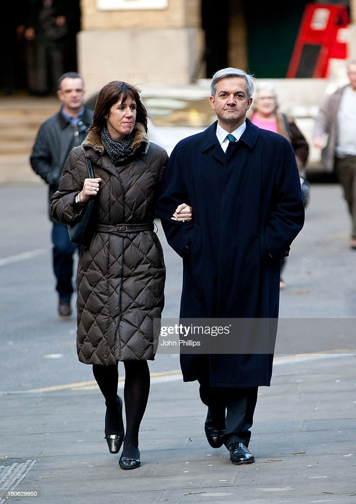 Former Cabinet Minister Chris Huhne arrives at Southwark Crown Court with Carina Trimingham on February 4, 2013 in London, England. Former Cabinet member Chris Huhne, 58, and his ex-wife Vicky Pryce are on trial over allegations that Pryce, 60, took penalty points on her driving licence in 2003 so that he could avoid prosecution.