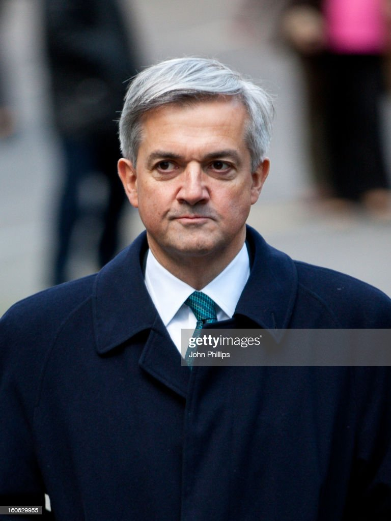 Former Cabinet Minister Chris Huhne arrives at Southwark Crown Court on February 4, 2013 in London, England. Former Cabinet member Chris Huhne, 58, and his ex-wife Vicky Pryce are on trial over allegations that Pryce, 60, took penalty points on her driving licence in 2003 so that he could avoid prosecution.