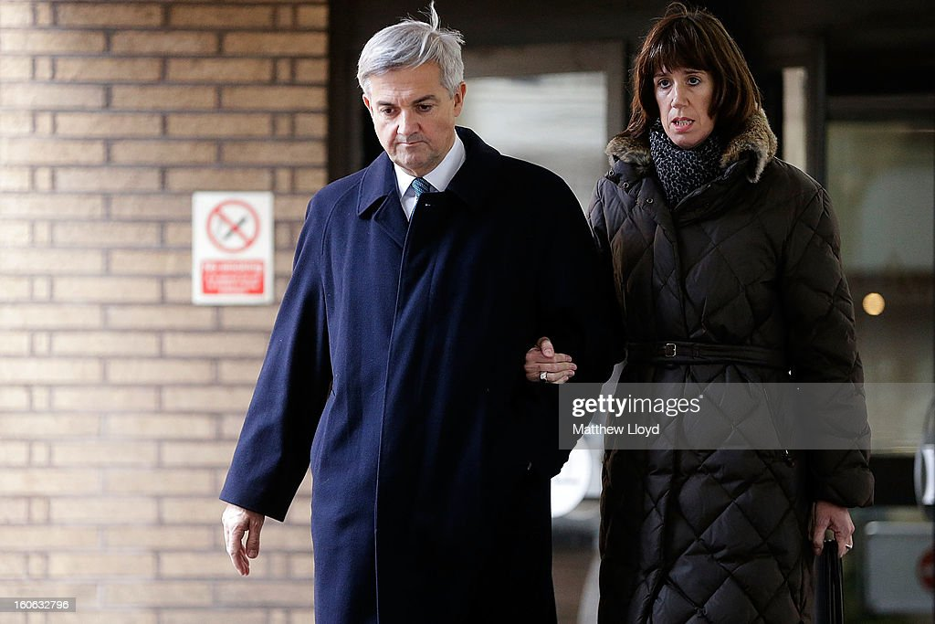 Former Cabinet Minister Chris Huhne leaves Southwark Crown Court with Carina Trimingham on February 4, 2013 in London, England. Huhne, 58, and his ex-wife Vicky Pryce are on trial over allegations that Pryce, 60, took penalty points on her driving licence in 2003 so that he could avoid prosecution. Chris Huhne pleaded guilty to perverting the course of justice.
