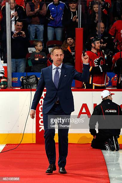 Former Calgary Flames forward Gary Roberts acknowledges the crowd for a puck drop ceremony before the game against the Minnesota Wild at Scotiabank...