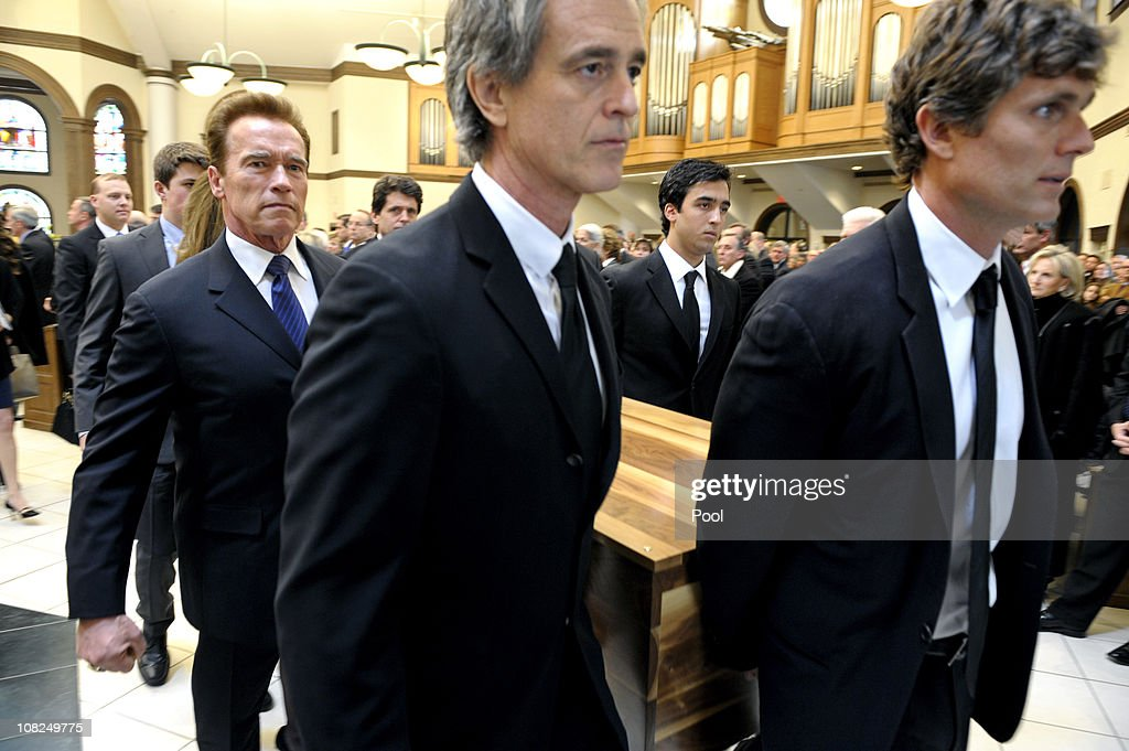 Former California Gov. <a gi-track='captionPersonalityLinkClicked' href=/galleries/search?phrase=Arnold+Schwarzenegger&family=editorial&specificpeople=156406 ng-click='$event.stopPropagation()'>Arnold Schwarzenegger</a> (L) with Robert 'Bobby' Shriver III (C), and <a gi-track='captionPersonalityLinkClicked' href=/galleries/search?phrase=Anthony+Shriver&family=editorial&specificpeople=727552 ng-click='$event.stopPropagation()'>Anthony Shriver</a> (R) carry the casket during the funeral service for Sargent Shriver at Our Lady of Mercy Catholic Church January 22, 2011 in Potomac, Maryland. Robert Sargent Shriver Jr., a politician and activist who was the first leader of the Peace Corps and was involved in other social programs, died this week at the age of 95.