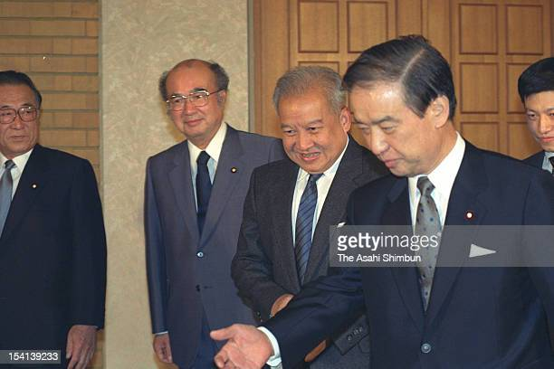 Former Cambodian King Prince Norodom Sihanouk is welcomed by Japanese Prime Minister Toshiki Kaifu prior to their meeting at Kaifu's official...