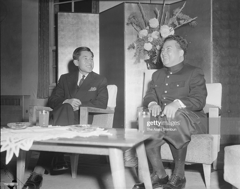 Former Cambodian King, Prince Norodom Sihanouk (R) speaks with Japanese Crown Prince Akihito (L) on December 9, 1955 in Tokyo, Japan.