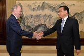 Former Canadian Premier Jean Chretien and Chinese Premier Li Keqiang shake hands before their meeting at the Zhongnanhai leadership compound in...