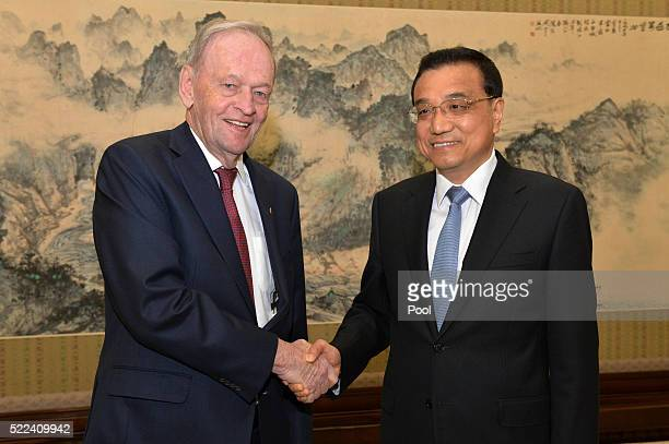Former Canadian Premier Jean Chretien  and Chinese Premier Li Keqiang shake hands before their meeting at the Zhongnanhai leadership compound on...