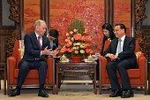 Former Canadian Premier Jean Chretien talks with Chinese Premier Li Keqiang during their meeting at the Zhongnanhai leadership compound in Beijing...