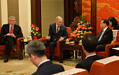 Former Canadian Premier Jean Chretien talks with Chinese Premier Li Keqiang during their meeting at the Zhongnanhai leadership compound on April 19...