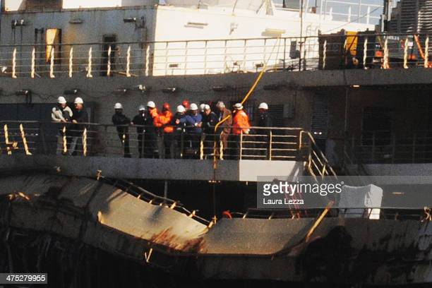 Former Captain of the Costa Concordia Francesco Schettino is seen aboard the ship with the team of experts inspecting the wreck on February 27 2014...