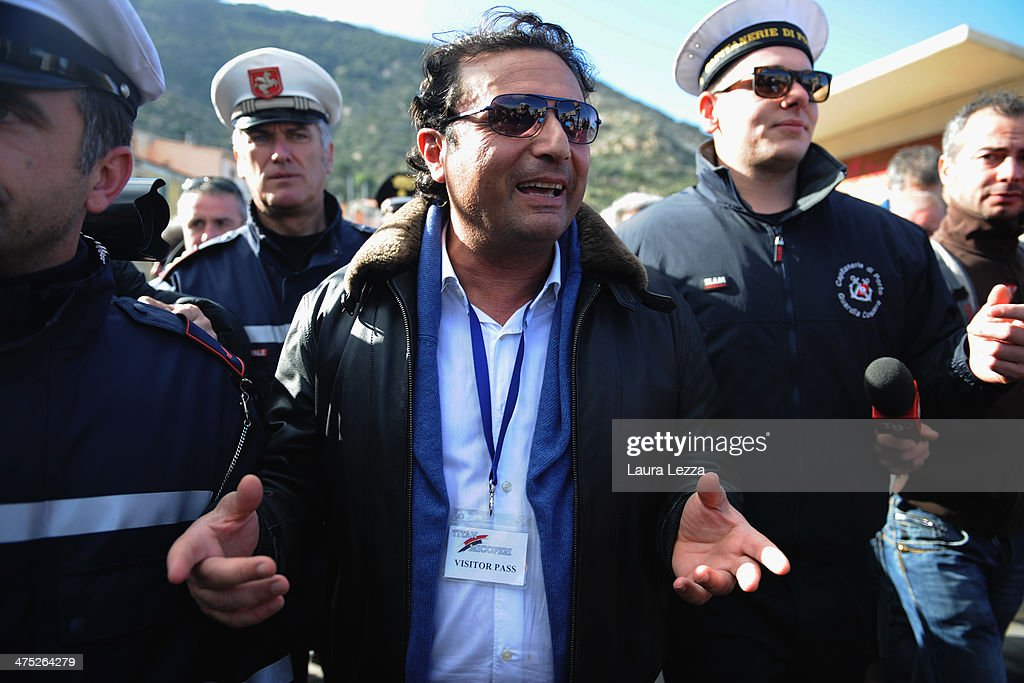 Former Captain of the Costa Concordia <a gi-track='captionPersonalityLinkClicked' href=/galleries/search?phrase=Francesco+Schettino&family=editorial&specificpeople=8797246 ng-click='$event.stopPropagation()'>Francesco Schettino</a> speaks with reporters after being aboard the ship with the team of experts inspecting the wreck on February 27, 2014 in Isola del Giglio, Italy. The Italian captain went back onboard the wreck of the Costa Concordia for the first time since the sinking of the cruise ship on January 13, 2012, as part of his trial for manslaughter and abandoning ship. The Court of Grosseto has allowed him to return to the ship, as a defendant, to accompany a group of court-appointed experts examining the vessel along with its emergency generators and on-board elevators.