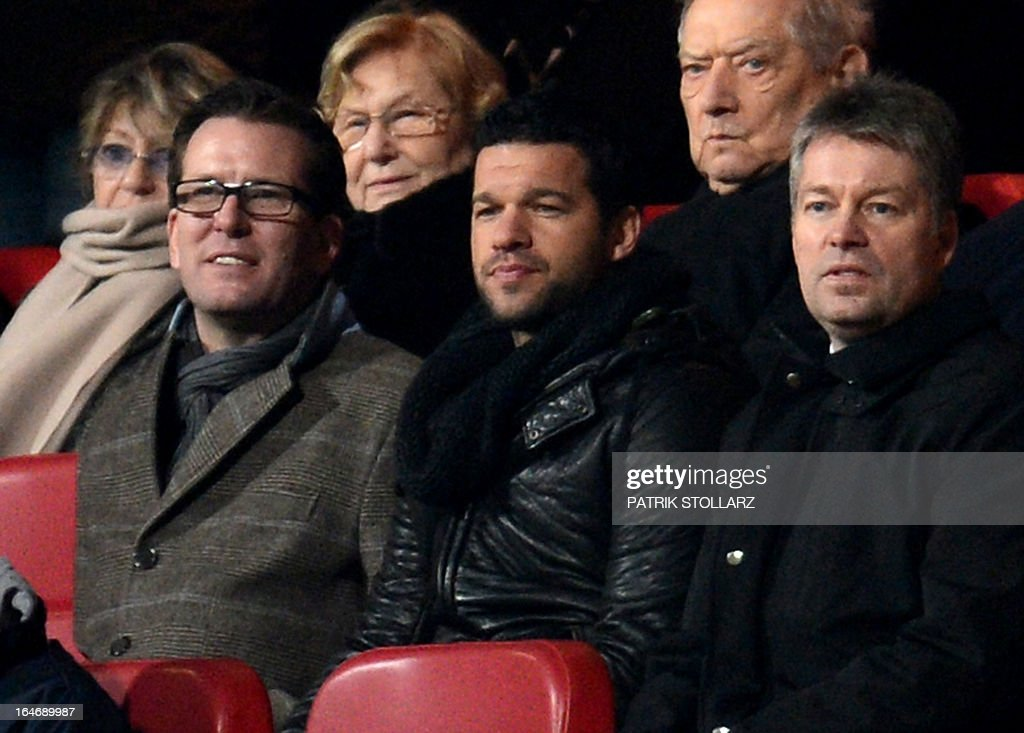 Former captain of the German national team Michael Ballack (C) follows the game on the tribune during the Germany vs Kazakhstan FIFA 2014 World Cup qualifying football match in Nuremberg, on March 26, 2013. AFP PHOTO / PATRIK STOLLARZ