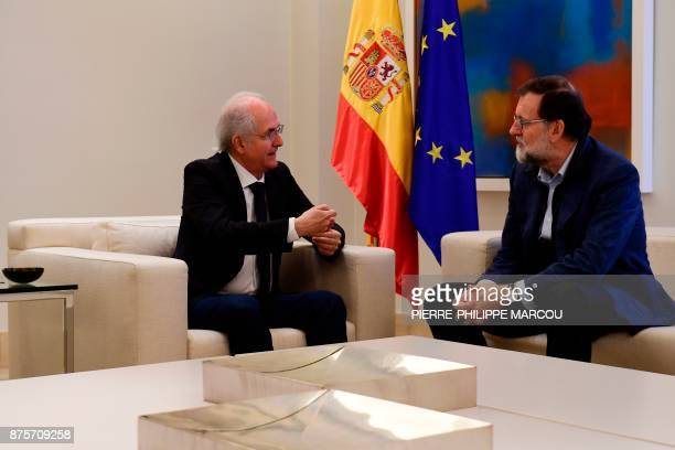 Former Caracas mayor Antonio Ledezma speaks to Spanish Prime Minister Mariano Rajoy during a meeting in Madrid on November 18 2017 Ledezma arrived...
