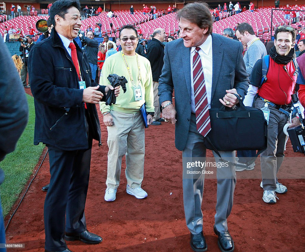 Former Cardinals manager Tony LaRussa, right, who was the skipper in 2004 when the Red Sox beat his team in the World Series, brought a smile to the face of So Taguchi, left, who was an outfielder on that same team, when he did a backwards duck walk when he saw him on the field during batting practice. The St. Louis Cardinals host the Boston Red Sox at Busch Stadium for Game Three of the 2013 Major League Baseball World Series, Oct. 26, 2013.