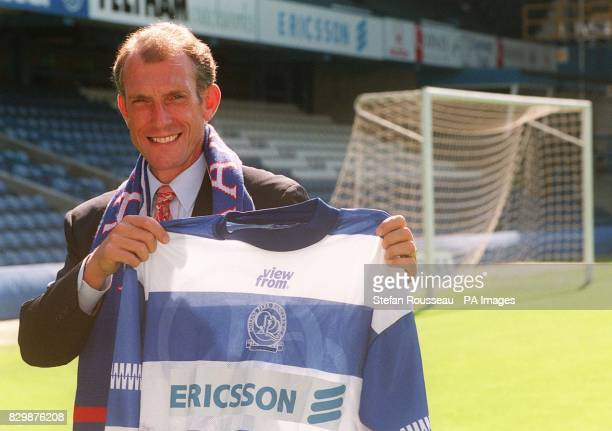 Former caretaker manager at Arsenal Stewart Houston holds up his new colours today at Loftus Road after joining London rivals Queens Park Rangers...