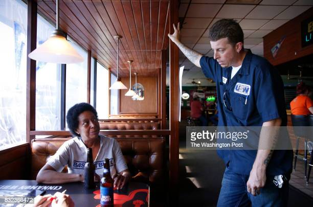 Former Carrier employee Brenda Battle talks to TJ Bray at Sully's Sports Bar Grill in Indianapolis Indiana July 20 2017