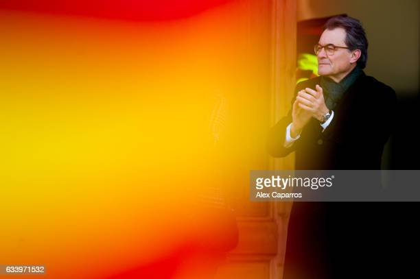Former Catalan President Artur Mas applauds to the crowd as he arrives to the Catalonia's Superior Court of Justice to face trial over Catalonia...