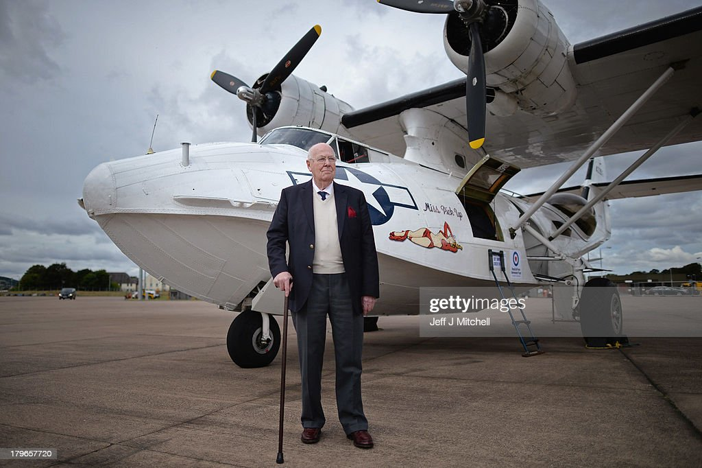 Former Catalina pilot, ninety four year old John Cruickshank VC, stands beside a Catalina amphibious long range maritime patrol and bomber aircraft on display at RAF Leuchars airshow on September 6, 2013 in St Andrews, Scotland. Defence Minister Dr. Andrew Murrison announced that this weekends airshow at RAF Leuchars will be the last in its current form, as the RAF station is transitioning from an RAF base to an Army base by 2015.