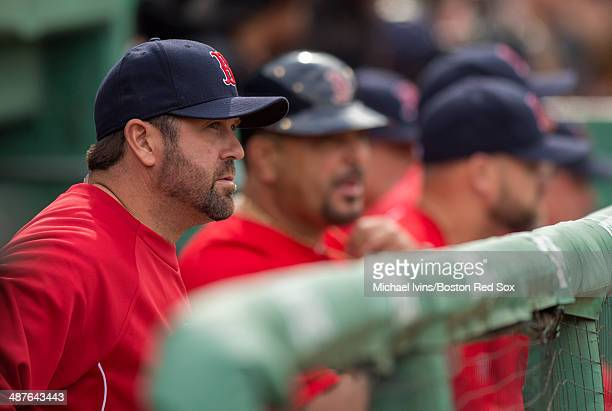 Former catcher and current Special Assistant to the General Manager Jason Varitek of the Boston Red Sox watches the first game of a doubleheader...