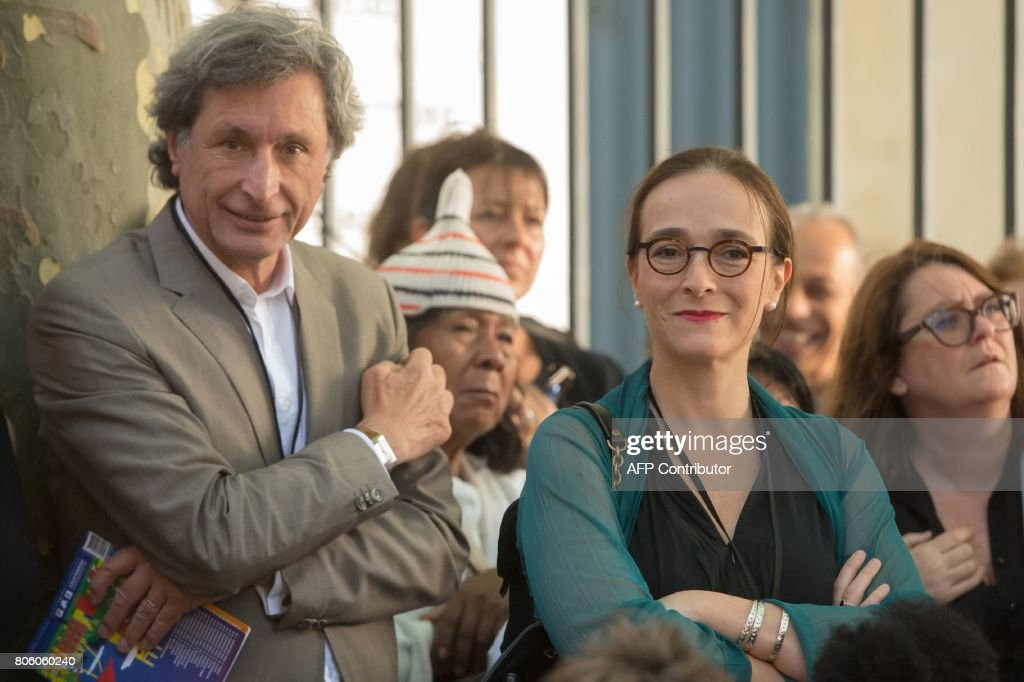 Former CEO of French media group France Televisions Patrick De Carolis (L) and actual CEO of France Televisions Delphine Ernotte (R) attend the official opening of the photography festival 'Rencontres de la photographie d'Arles 2017' in Arles, southern France, on July 3, 2017. The festival is held until September 24. /