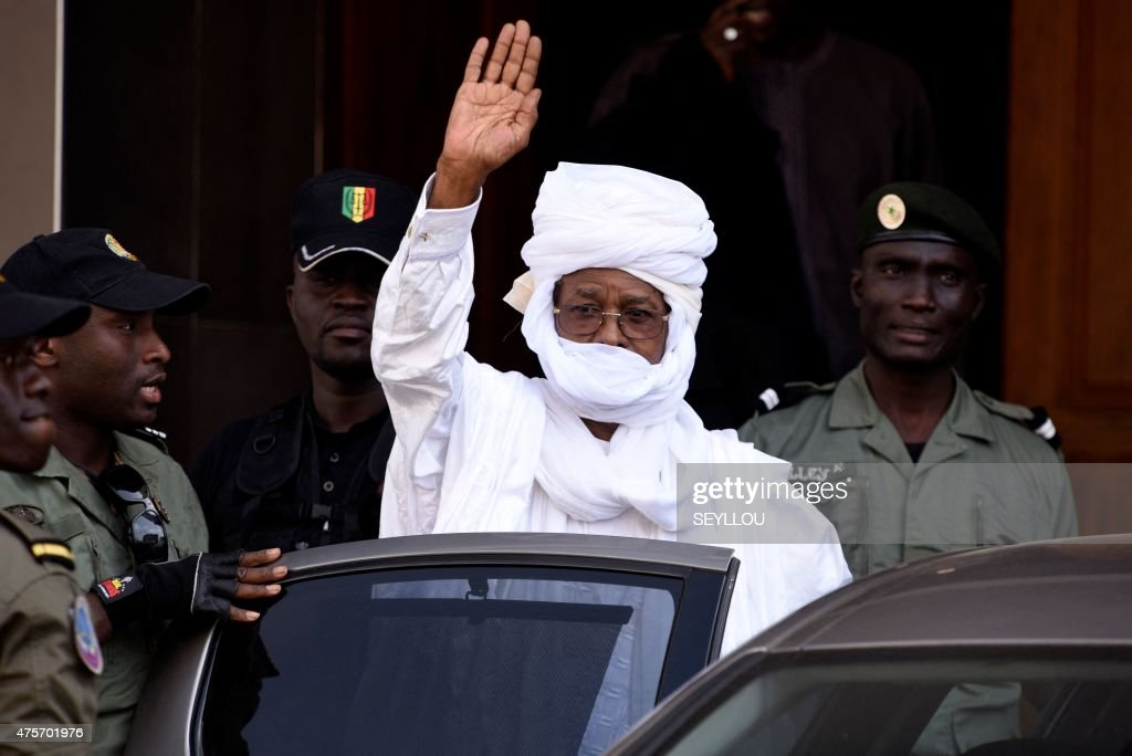 Former Chadian dictator <a gi-track='captionPersonalityLinkClicked' href=/galleries/search?phrase=Hissene+Habre&family=editorial&specificpeople=1043137 ng-click='$event.stopPropagation()'>Hissene Habre</a> gestures as he leaves a Dakar courthouse after an identity hearing on June 3, 2015. Habre, who has been in custody in Senegal since his arrest in June 2013, will stand trial in Dakar for torture, war crimes and crimes against humanity from July 20 onwards, the special tribunal set up to judge him said on June 3.