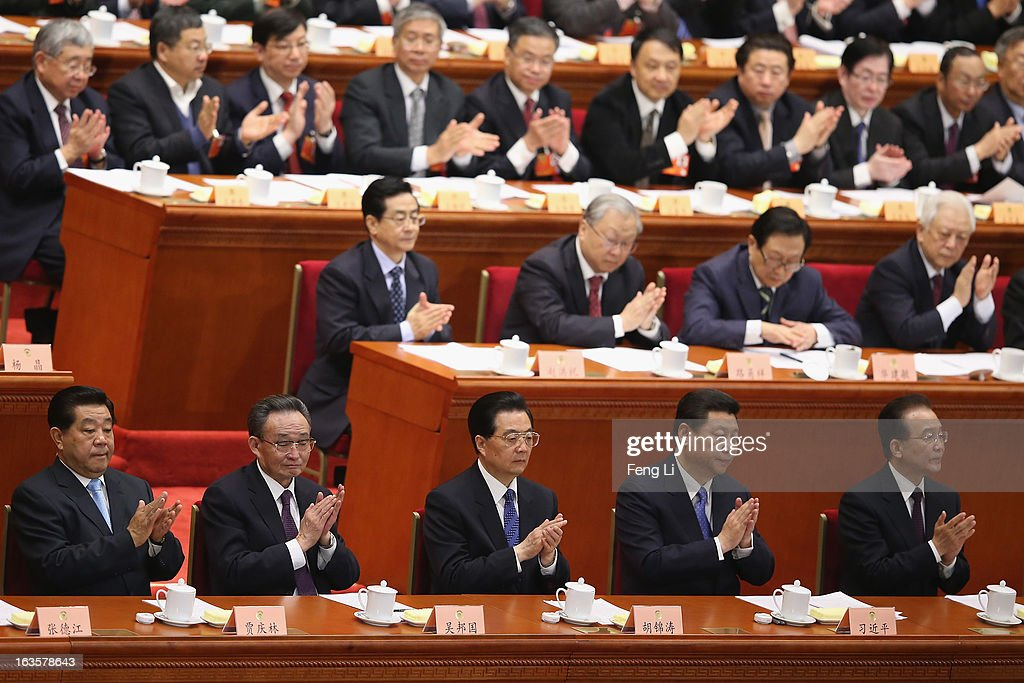 Former Chairman of Chinese People's Political Consultative Conference (CPPCC) <a gi-track='captionPersonalityLinkClicked' href=/galleries/search?phrase=Jia+Qinglin&family=editorial&specificpeople=687988 ng-click='$event.stopPropagation()'>Jia Qinglin</a>, outgoing Chairman of the National People's Congress <a gi-track='captionPersonalityLinkClicked' href=/galleries/search?phrase=Wu+Bangguo&family=editorial&specificpeople=604934 ng-click='$event.stopPropagation()'>Wu Bangguo</a>, Chinese President <a gi-track='captionPersonalityLinkClicked' href=/galleries/search?phrase=Hu+Jintao&family=editorial&specificpeople=203109 ng-click='$event.stopPropagation()'>Hu Jintao</a>, Chinese Communist Party chief and incoming-President <a gi-track='captionPersonalityLinkClicked' href=/galleries/search?phrase=Xi+Jinping&family=editorial&specificpeople=2598986 ng-click='$event.stopPropagation()'>Xi Jinping</a>, Chinese Premier <a gi-track='captionPersonalityLinkClicked' href=/galleries/search?phrase=Wen+Jiabao&family=editorial&specificpeople=204598 ng-click='$event.stopPropagation()'>Wen Jiabao</a> and incoming-Premier Li Keqiang applaud during the closing session of the annual CPPCC held at the Great Hall of the People on March 12, 2013 in Beijing, China. The newly-elected Chairman of the CPPCC Yu Zhengsheng pledged Tuesday that China will not copy Western political systems under any circumstances.