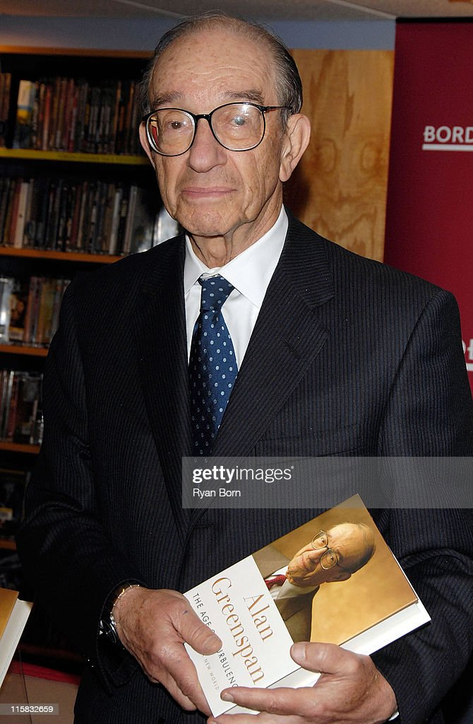 Former Chairman of the Board of Governors of the Federal Reserve Alan Greenspan signs copies of his new book 'The Age of Turbulence Adventures in a...