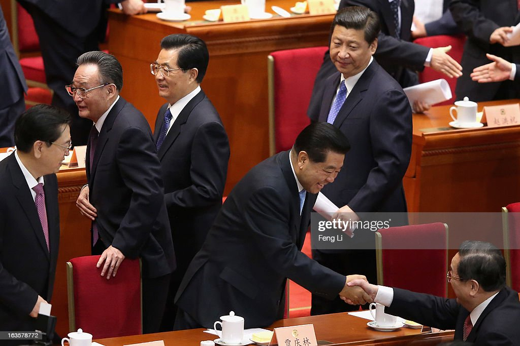 Former chairman of the Chinese People's Political Consultative Conference <a gi-track='captionPersonalityLinkClicked' href=/galleries/search?phrase=Jia+Qinglin&family=editorial&specificpeople=687988 ng-click='$event.stopPropagation()'>Jia Qinglin</a> (bottom left) shakes hands with the newly-appointed chairman of the CPPCC Yu Zhengsheng (bottom) while incoming-Chairman of the National People's Congress Zhang Dejiang (left), outgoing Chairman of the National People's Congress <a gi-track='captionPersonalityLinkClicked' href=/galleries/search?phrase=Wu+Bangguo&family=editorial&specificpeople=604934 ng-click='$event.stopPropagation()'>Wu Bangguo</a> (2nd left), Chinese President <a gi-track='captionPersonalityLinkClicked' href=/galleries/search?phrase=Hu+Jintao&family=editorial&specificpeople=203109 ng-click='$event.stopPropagation()'>Hu Jintao</a> (2nd right) and incoming-President <a gi-track='captionPersonalityLinkClicked' href=/galleries/search?phrase=Xi+Jinping&family=editorial&specificpeople=2598986 ng-click='$event.stopPropagation()'>Xi Jinping</a> (right) walk past after the closing session of the annual CPPCC held at the Great Hall of the People on March 12, 2013 in Beijing, China. The newly-elected Chairman of the CPPCC Yu Zhengsheng pledged Tuesday that China will not copy Western political systems under any circumstances.