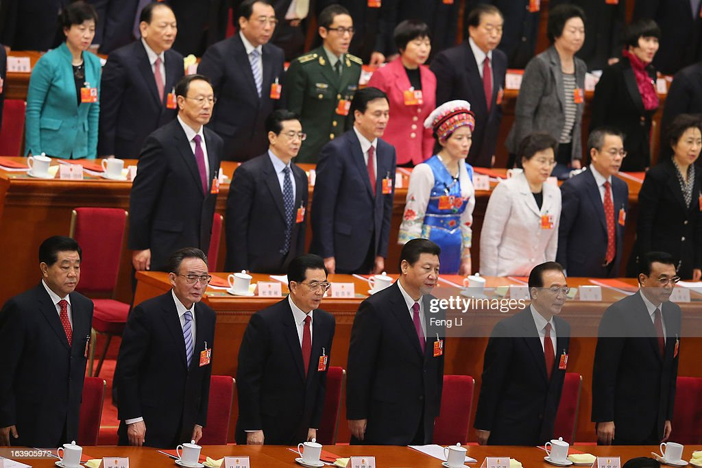 Former chairman of the Chinese People's Political Consultative Conference <a gi-track='captionPersonalityLinkClicked' href=/galleries/search?phrase=Jia+Qinglin&family=editorial&specificpeople=687988 ng-click='$event.stopPropagation()'>Jia Qinglin</a>, former Chairman of the National People's Congress <a gi-track='captionPersonalityLinkClicked' href=/galleries/search?phrase=Wu+Bangguo&family=editorial&specificpeople=604934 ng-click='$event.stopPropagation()'>Wu Bangguo</a>, former Chinese president <a gi-track='captionPersonalityLinkClicked' href=/galleries/search?phrase=Hu+Jintao&family=editorial&specificpeople=203109 ng-click='$event.stopPropagation()'>Hu Jintao</a>, newly-elected Chinese President <a gi-track='captionPersonalityLinkClicked' href=/galleries/search?phrase=Xi+Jinping&family=editorial&specificpeople=2598986 ng-click='$event.stopPropagation()'>Xi Jinping</a>, former Premier <a gi-track='captionPersonalityLinkClicked' href=/galleries/search?phrase=Wen+Jiabao&family=editorial&specificpeople=204598 ng-click='$event.stopPropagation()'>Wen Jiabao</a> and newly-elected Chinese Premier <a gi-track='captionPersonalityLinkClicked' href=/galleries/search?phrase=Li+Keqiang&family=editorial&specificpeople=2481781 ng-click='$event.stopPropagation()'>Li Keqiang</a> sing the national anthem during the closing session of the National People's Congress (NPC) at the Great Hall of the People on March 17, 2013 in Beijing, China. China's newly-elected president <a gi-track='captionPersonalityLinkClicked' href=/galleries/search?phrase=Xi+Jinping&family=editorial&specificpeople=2598986 ng-click='$event.stopPropagation()'>Xi Jinping</a> pledged Sunday to resolutely fight against corruption and other misconduct in all manifestations.