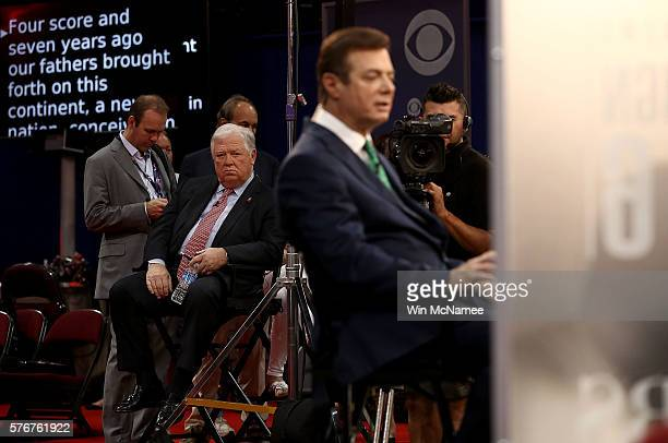 Former Chairman of the Republican National Committee Haley Barbour watches as Paul Manafort campaign manager for Republican presidential candidate...