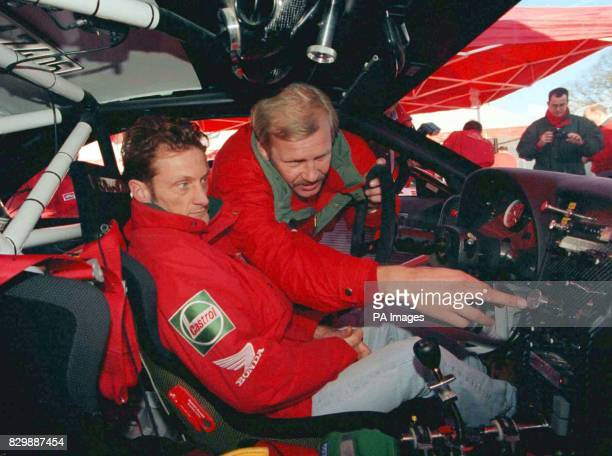 Former champion Juha Kankkunen explains the cockpit of his Toyota GT 4 to Karl Fogerty during the final preparations for this weekend's RAC Rally The...