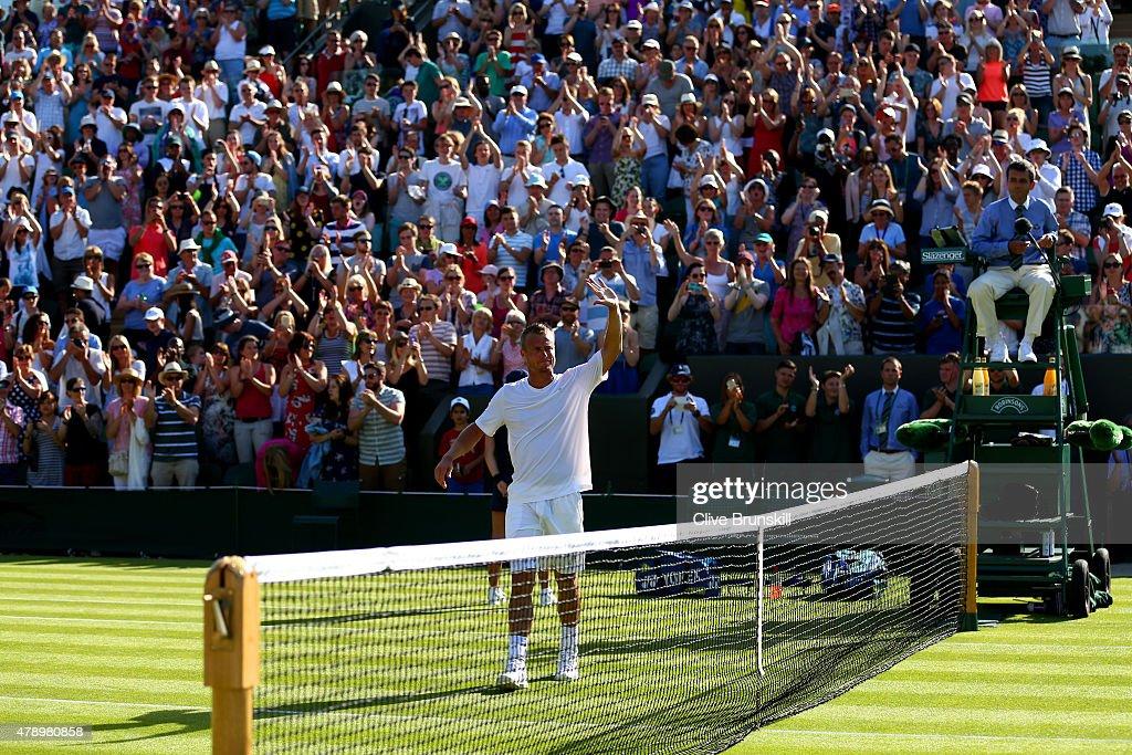 Former champion Lleyton Hewitt of Australia acknowledges the crowd following his defeat to Jarkko Nieminen of Finland in his last ever Gentlemen's...