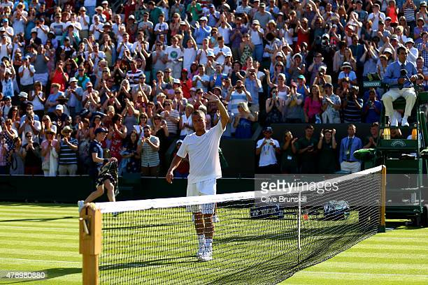 Former champion Lleyton Hewitt of Australia acknowledges the crowd following his defeat to Jarkko Nieminen of Finland in his last ever Gentlemen's...