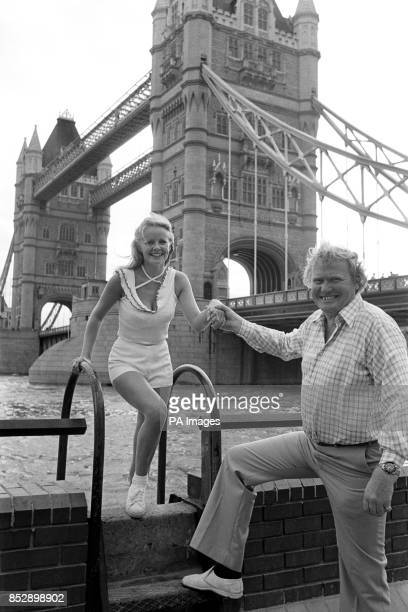 Former champion National Hunt jockey Terry Biddlecombe helps his teammate Linda Cunningham ashore near Tower Bridge after they had competed in the...