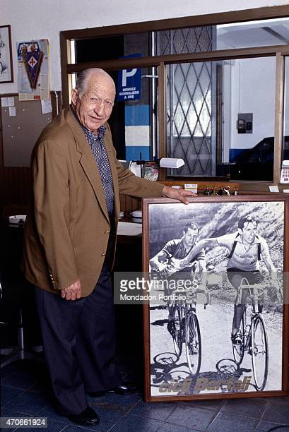 'Former champion road cyclist Gino Bartali taken into his home shows to the camera some of the memorabilia of his long lasting and glorious career...