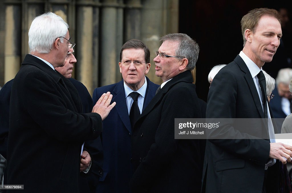 Former Chancellor <a gi-track='captionPersonalityLinkClicked' href=/galleries/search?phrase=Alistair+Darling&family=editorial&specificpeople=217473 ng-click='$event.stopPropagation()'>Alistair Darling</a>, Former NATO Secretary General Lord <a gi-track='captionPersonalityLinkClicked' href=/galleries/search?phrase=George+Robertson&family=editorial&specificpeople=158921 ng-click='$event.stopPropagation()'>George Robertson</a>, Brian Wilson and Shadow Secretary of State for Defence <a gi-track='captionPersonalityLinkClicked' href=/galleries/search?phrase=Jim+Murphy+-+Politician&family=editorial&specificpeople=13566433 ng-click='$event.stopPropagation()'>Jim Murphy</a> attend the memorial service of former Scottish Secretary and European Commissioner Bruce Millan at Govan Parish Church on March 4, 2013 in Glasgow, Scotland. Bruce Millan died last Thursday aged 85 he had recently been diagnosed with cancer.