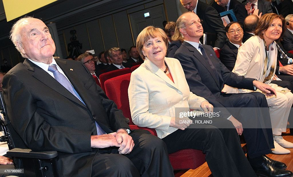 Former chancellor <a gi-track='captionPersonalityLinkClicked' href=/galleries/search?phrase=Helmut+Kohl&family=editorial&specificpeople=202518 ng-click='$event.stopPropagation()'>Helmut Kohl</a>, German chancellor <a gi-track='captionPersonalityLinkClicked' href=/galleries/search?phrase=Angela+Merkel&family=editorial&specificpeople=202161 ng-click='$event.stopPropagation()'>Angela Merkel</a> sit next to BASF CEO <a gi-track='captionPersonalityLinkClicked' href=/galleries/search?phrase=Kurt+Bock&family=editorial&specificpeople=2540103 ng-click='$event.stopPropagation()'>Kurt Bock</a> before the start of an event to celebrate the 150th anniversary of German chemicals company BASF at its headquarter in Ludwigshafen am Rhein, western Germany, on April 23, 2015. ROLAND