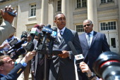 Former Charlotte NC mayor Patrick Cannon center makes a statement to the media outside the Charles R Jonas Federal Building US Courthouse following...