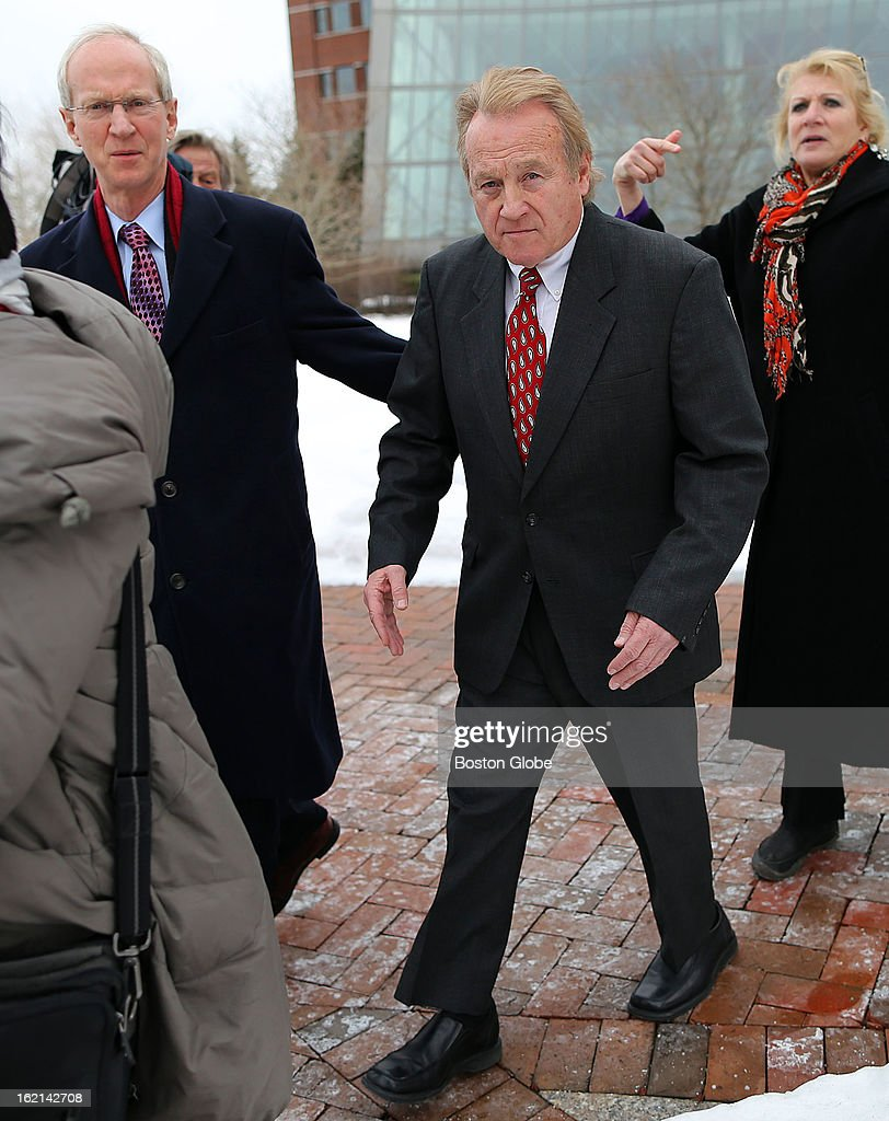 Former Chelsea Housing Authority chief Michael McLaughlin leaves Moakley Federal Court after a hearing in which he pleaded guilty to four counts of deliberately concealing his inflated salary from state and federal regulators from 2008 until he was forced to resign in 2011. His lawyer, Tom Hoopes, left, guides him through a maze of reporters.
