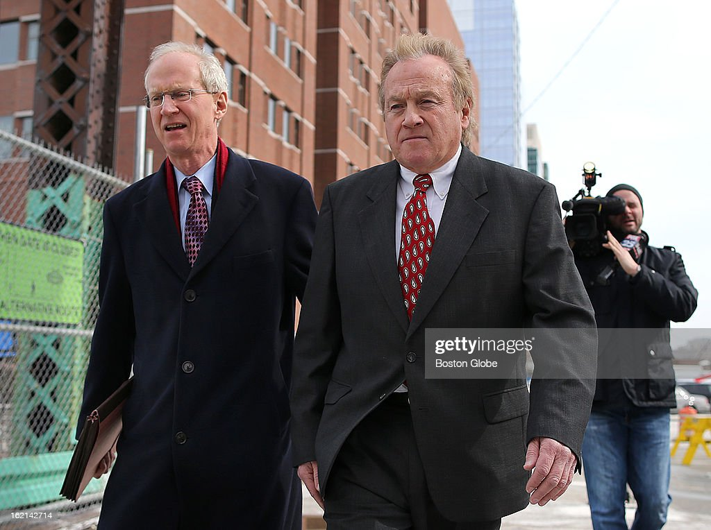 Former Chelsea Housing Authority chief Michael McLaughlin leaves Moakley Federal Court after a hearing in which he pleaded guilty to four counts of deliberately concealing his ­inflated salary from state and federal regulators from 2008 until he was forced to resign in 2011. His lawyer, Tom Hoopes, left, walks with him across the Northern Avenue bridge.
