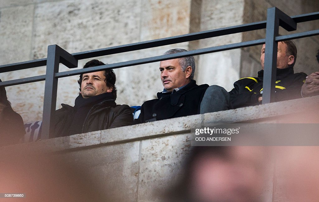 Former Chelsea manager José Mourinho (C) attends the German first division Bundesliga football match, Hertha Berlin v Borussia Dortmund, at the Olympic stadium in Berlin on February 6, 2016. / AFP / ODD ANDERSEN /