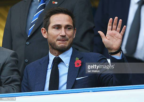 Former Chelsea player Frank Lampard waves on the stand prior to the Barclays Premier League match between Chelsea and Liverpool at Stamford Bridge on...