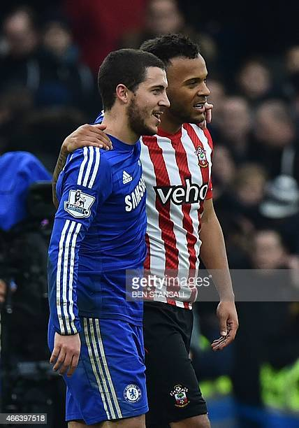 Former Chelsea player Southampton's English defender Ryan Bertrand walks off with his exteammate Chelsea's Belgian midfielder Eden Hazard at the...