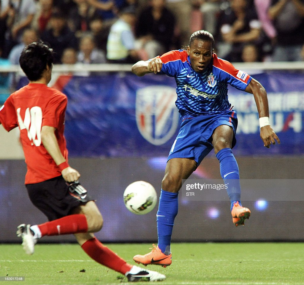 Former Chelsea star Didier Drogba of Shanghai Shenhua fields the ball before his team beat Liaoning Whowin 30 in the Chinese Super League match in...