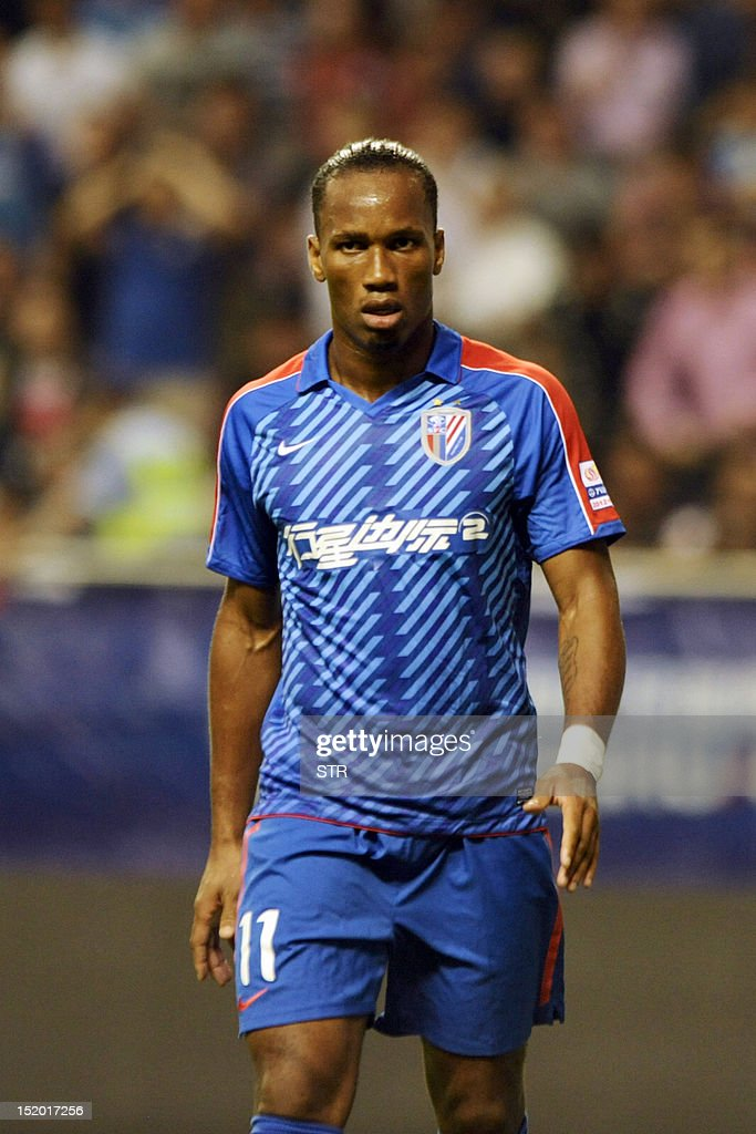 Former Chelsea star Didier Drogba of Shanghai Shenhua walks on the pitch, before his team beat Liaoning Whowin 3-0, in the Chinese Super League (CSL) match in Shanghai on September 15, 2012. The futures of Drogba and team-mate Anelka were put in doubt last month when a Shanghai newspaper claimed that eccentric owner Zhu Jun, who pays the huge wages of the star pair, had threatened to withdraw funding.