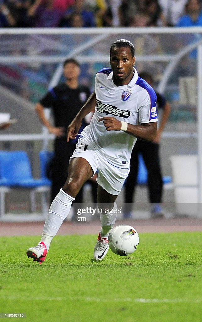 Former Chelsea striker Didier Drogba takes to the pitch for his new team Shanghai Shenhua teammates as he sets up his sides' equalizer against...